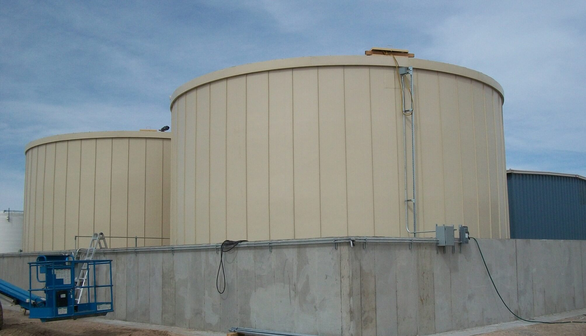 Ground Storage Tanks Cheyenne WY RIDGLOK® Vertical Standing Seam Insulated  Panel System Panels In Fawn Color